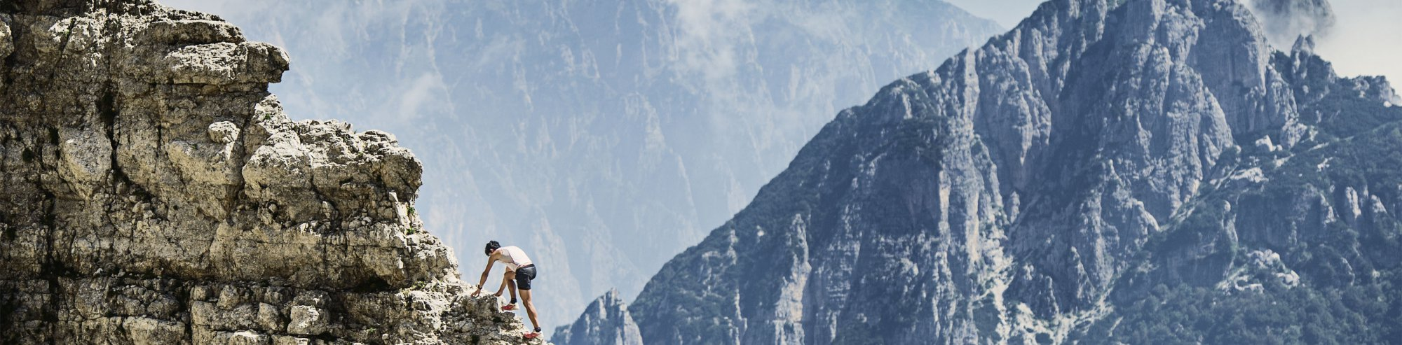 Killian Jornet scaling a mountain
