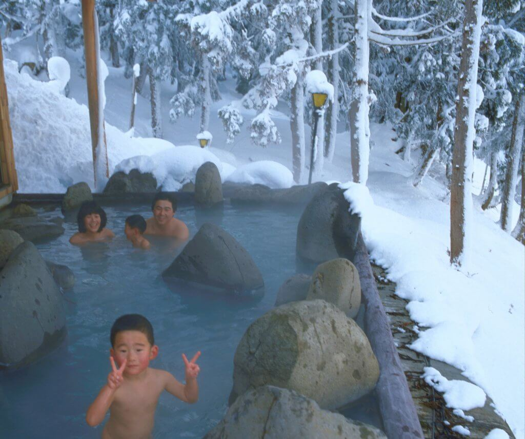 Family in an onsen