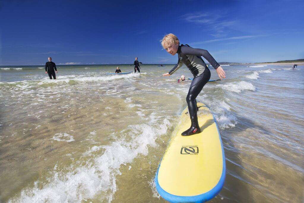 Surfing at Pollan Bay